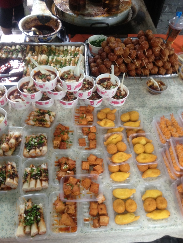 Sampling of Chengdu street food, no rabbits here though.